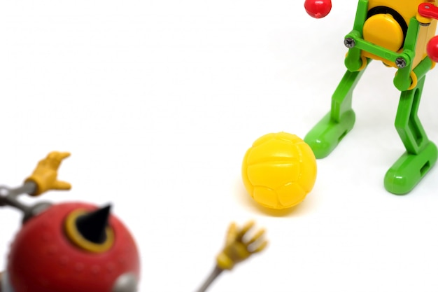 Toy robot are playing football, sport concept.