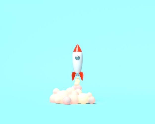 おもちゃのロケットが青色の背景に煙を吐き出す