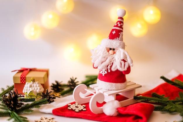 Toy santa claus on a sled christmas card