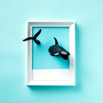 Toy sharks swimming in a frame