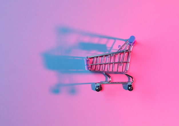 Toy shopping trolley with neon pink blue light.