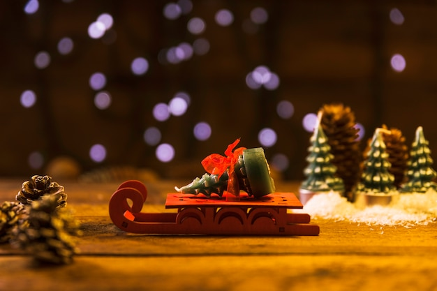 Toy sledge with decorative fir tree