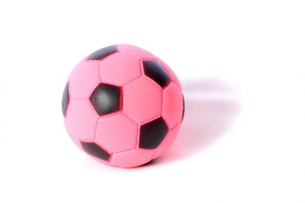 Игрушечный маленький футбол, изолированный на белом