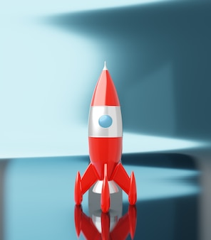 Игрушка космическая ракета красного и белого цветов на синем белом металлике, 3d-рендеринг
