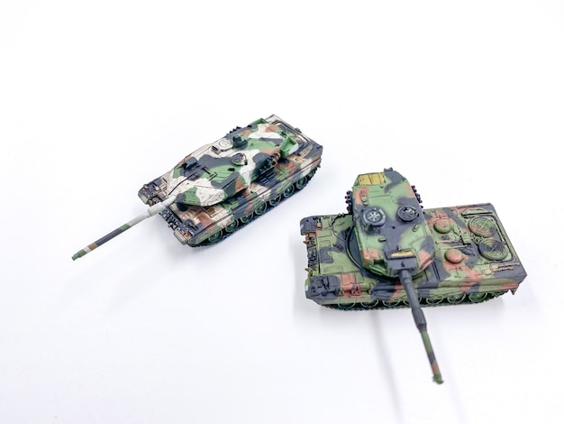Toy tank scale model on white background