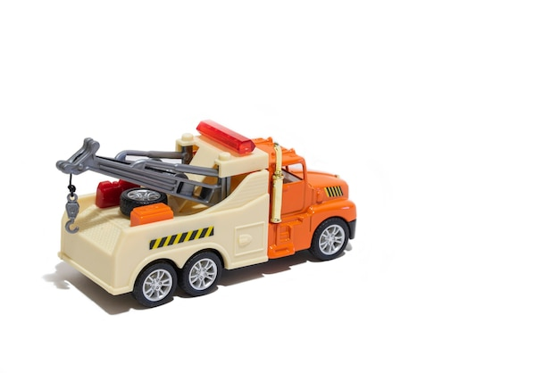 Toy tow truck on a white background childrens car for transporting cars