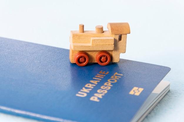 Toy train against the of the ukrainian biometric passport