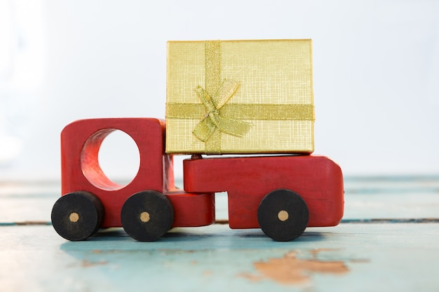 Toy truck with a golden gift