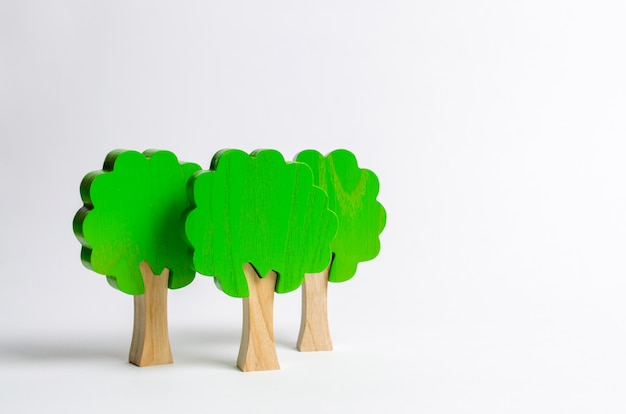 Toy wooden figures of trees on a white background