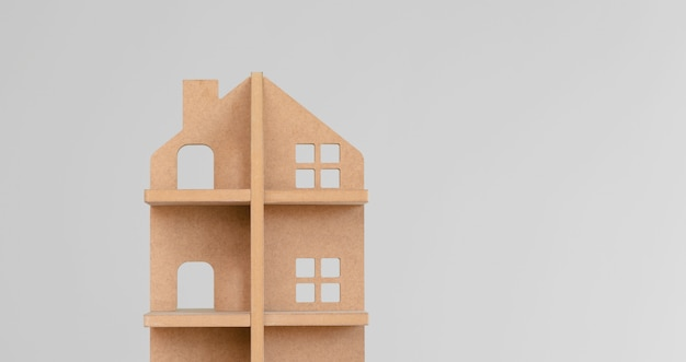 Toy wooden house on gray