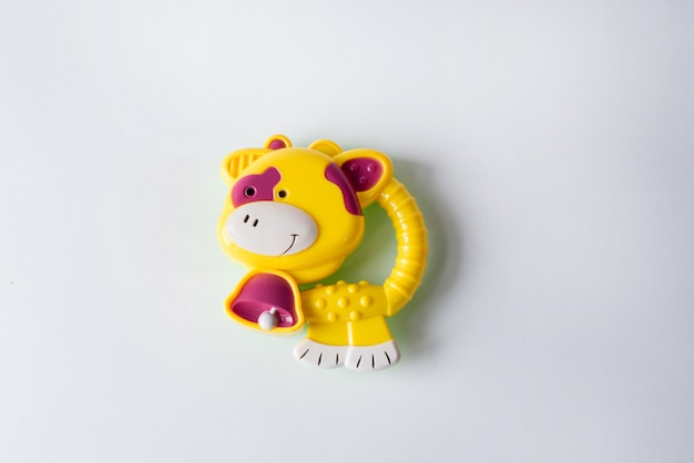Toy yellow cow isolated on white. toys for babies and newborn