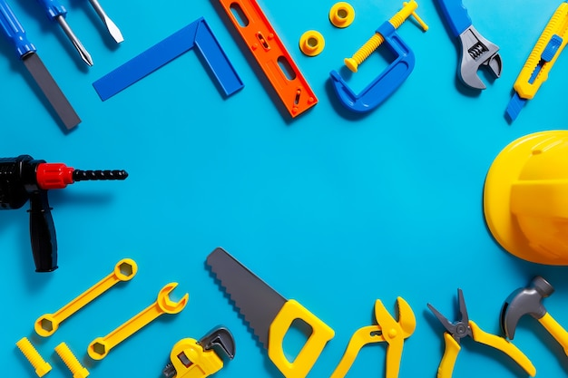Фон игрушки. вид сверху игрушечных инструментов на синем фоне с копией пространства для текста.