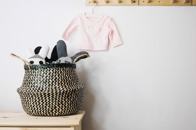 Toys in basket and baby t-shirt