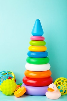 Toys collection for baby on blue background. top view