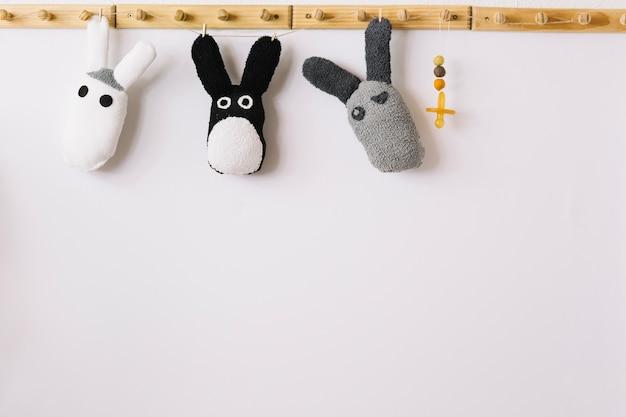 Toys on pegs