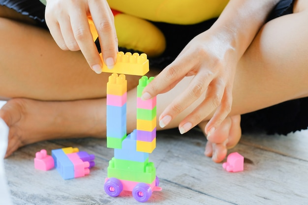 A toys playing in a hand