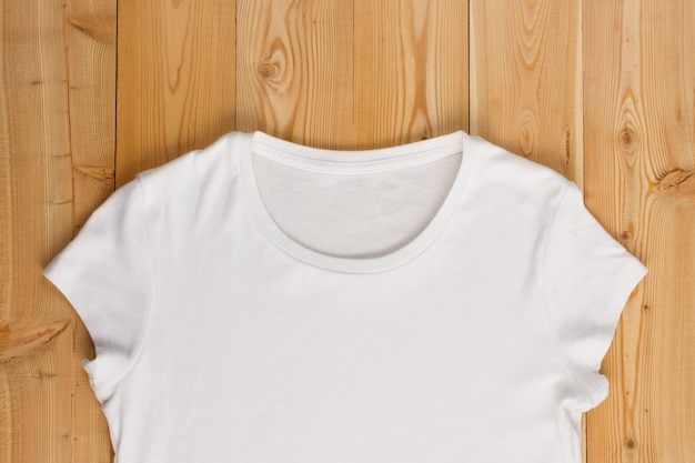Tp view of female t-shirt on a wooden background