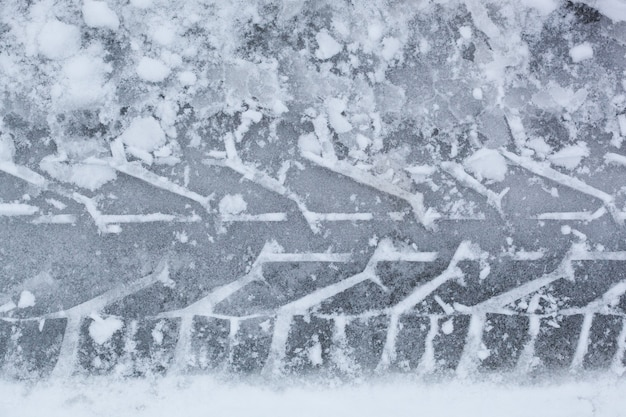Trace of car tire in the snow