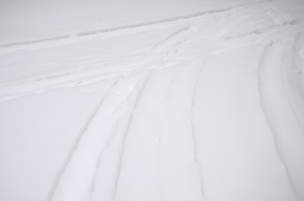 Traces from the wheels of the car on a snow-covered road.
