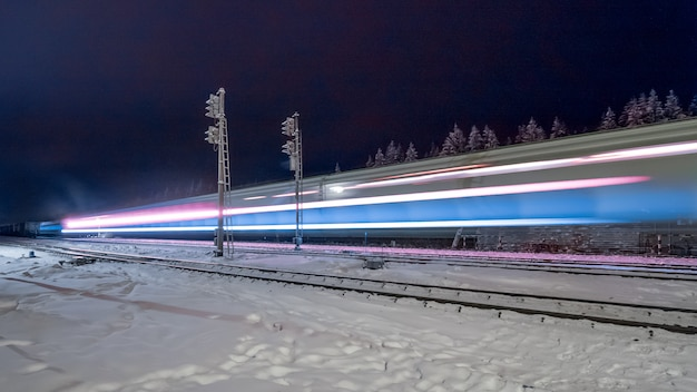 Traces of train lights on night railway