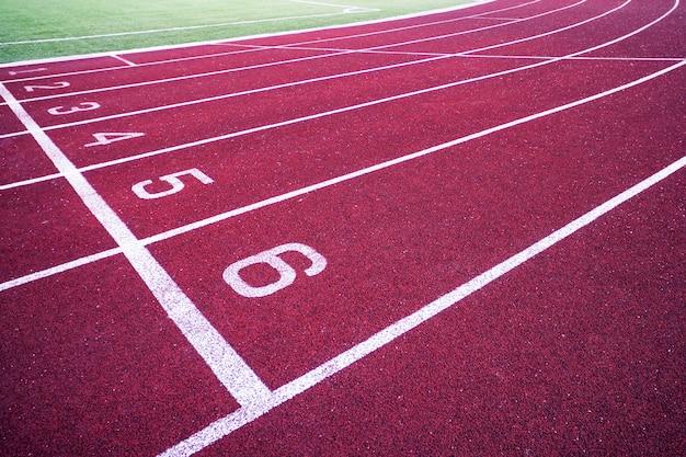 Track running, red treadmill in sport field.