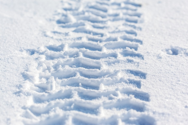 Tracks of car wheels in the snow