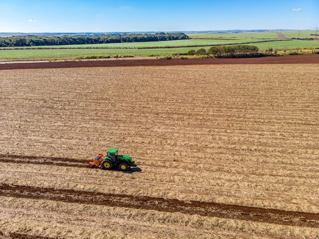 Tractor fertilizing an agricultural field
