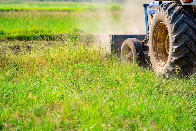 Tractor flowing on agriculture field in farmland
