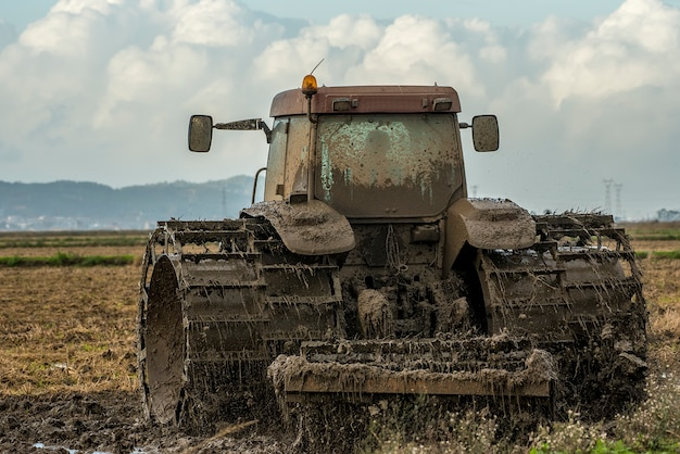 Tractor plowing rice fields