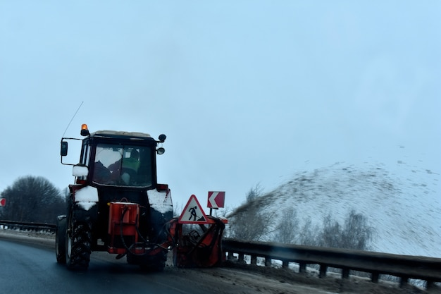 Tractor removes snow winter