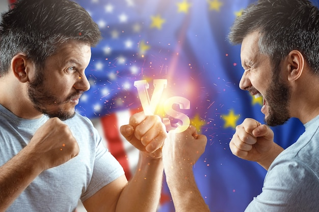 The trade war between the european union and the united states, two men are preparing for a fight with the american flag and the flag of the european union. sanctions, business.