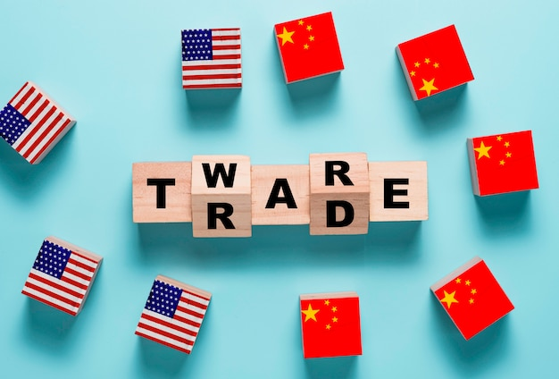 Trade war wording on wooden cubes block with usa and china flag.it is symbol of economic tariffs trade war and tax barrier between united states of america and china.