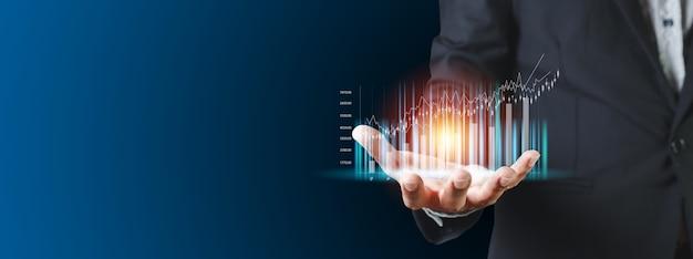 거래 막대 그래프 손 사업가, 증권 거래소 마케팅 분석 차트. 정보 통계 다이어그램 이익입니다. 투자 및 마케팅 개념입니다.