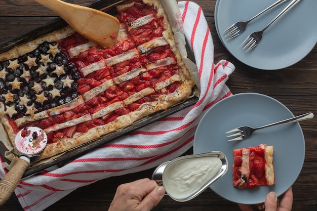 Traditional american independence day or labor day strawberry pie in the shape of a flag, top view