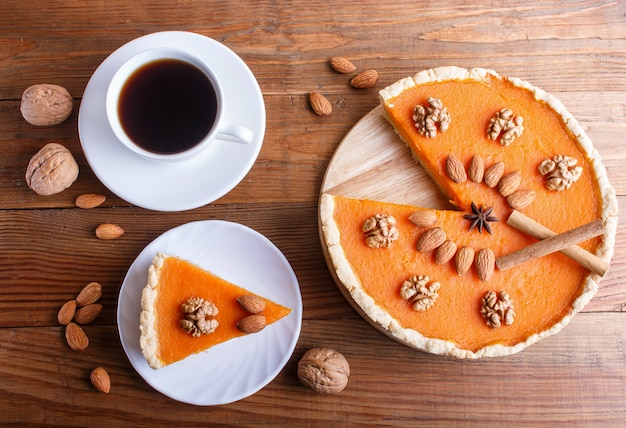 Traditional american sweet pumpkin pie decorated with nuts