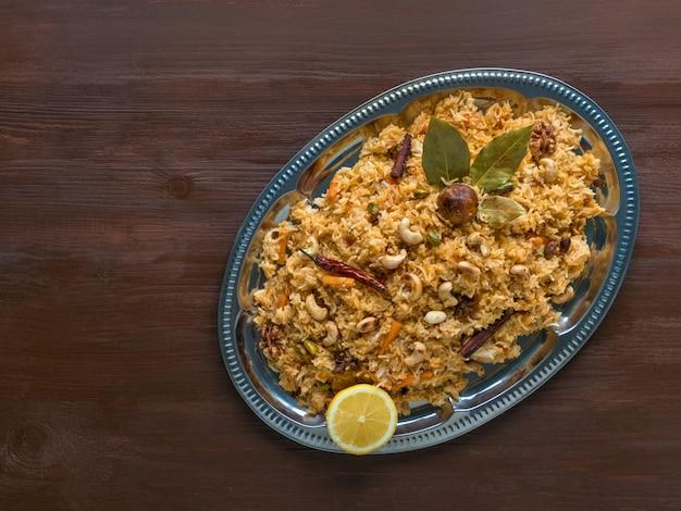 Traditional arabic basmati rice with vegetables. arabic cuisine. vegetable biryani. top view, copy space
