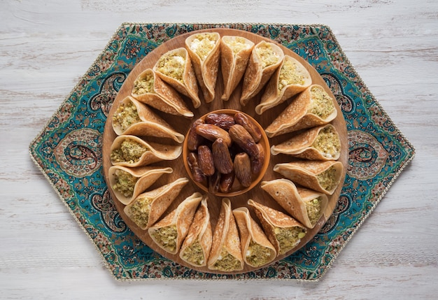 Traditional arabic crepes stuffed with cream, prepared for iftar in ramadan.