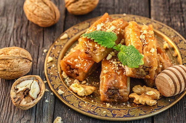 Traditional arabic dessert baklava with honey and walnuts