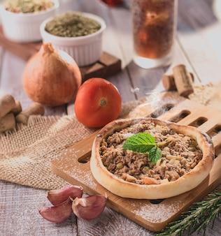 Traditional arabic esfiha of open meat (brazil)