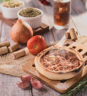 Traditional arabic esfiha of open pepperoni (brazil)
