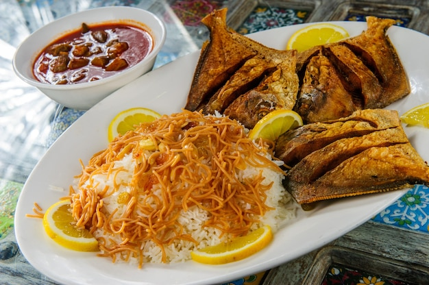 Traditional arabic mixed rice and grilled fish.