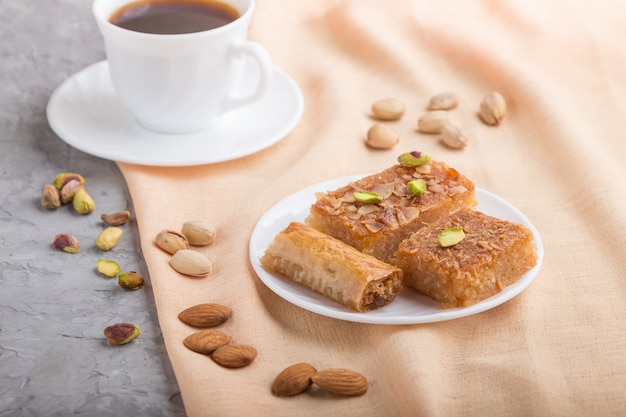 Traditional arabic sweets and a cup of coffee. side view