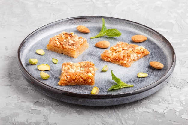 Traditional arabic sweets in gray ceramic plate