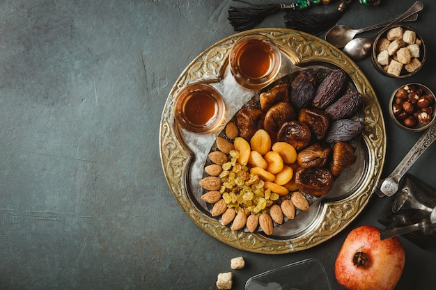 Traditional arabic tea and dry fruits and nuts, flat lay