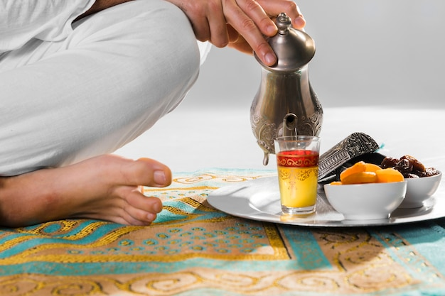 Traditional arabic tea and prayer rug