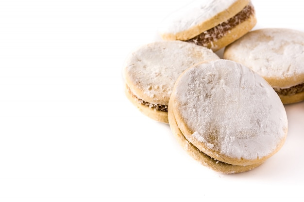 Traditional argentinian alfajores with dulce de leche and sugar isolated, copy space