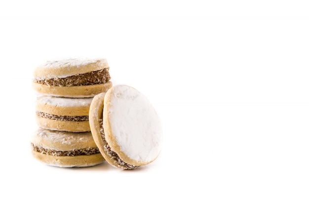 Traditional argentinian alfajores with dulce de leche and sugar isolated on white, copy space