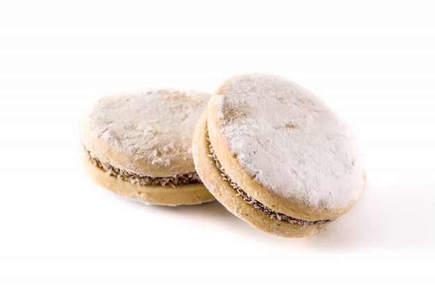 Traditional argentinian alfajores with dulce de leche and sugar isolated