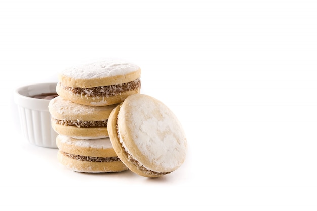 Traditional argentinian alfajores with dulce de leche and sugar isolated.