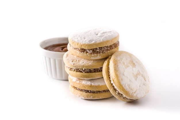 Traditional argentinian alfajores with dulce de leche and sugar.